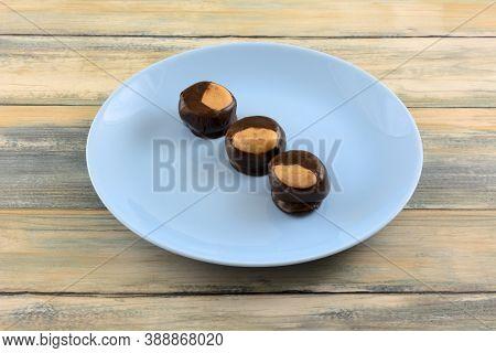 Buckeye Chocolate And Peanut Butter Balls Snacks On Blue Dessert Plate