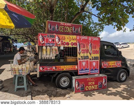 Denpasar, Indonesia - September 29, 2019: A Street Vendor Selling Ice Cream On Mertasari Beach Sanur