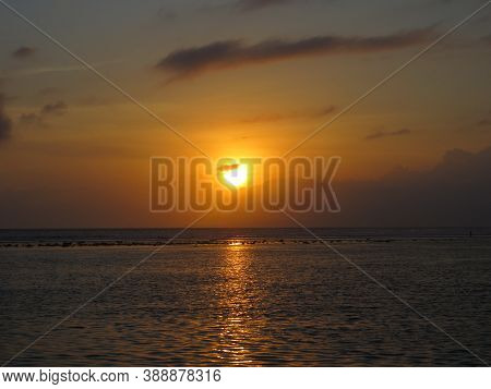 The Sun Rising On The Skyline On Sanur Beach.