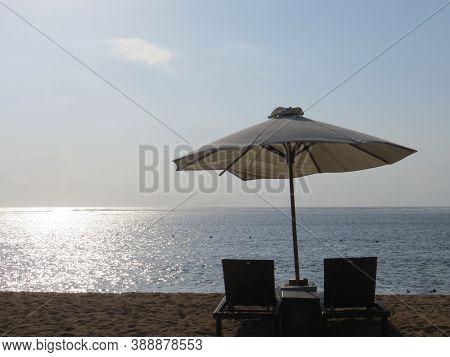 Denpasar, Indonesia - September 29, 2019: A Pair Of Beach Chairs On The Seaside Of Sanur Beach.
