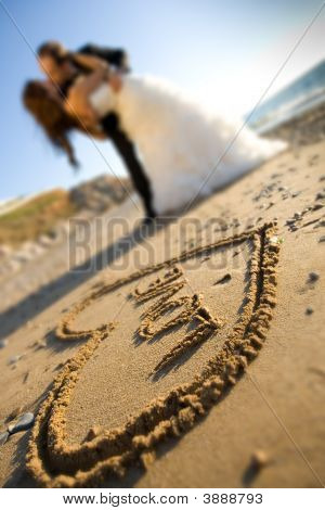 Happy Couple And Sand Of Love
