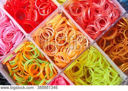 A Set Of Colorful Rubber Bands And Loom Knit For Knitting Wristbands. Close-up, Selective Focus