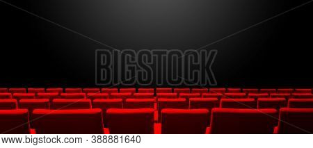 Cinema Movie Theatre With Red Seats Rows And A Black Copy Space Background. Horizontal Banner