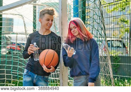 Active Healthy Lifestyle Of Teenagers 16, 17 Years Old In City. Couple With Trending Hairstyles On S