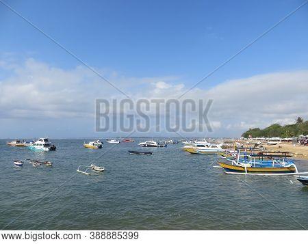 Denpasar, Indonesia - September 29, 2019: Many Ships Passing By On Mertasari Beach Sanur.