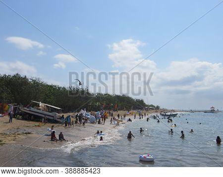 Denpasar, Indonesia - September 29, 2019: Crowd Of People Having Activities On Mertasari Beach Sanur