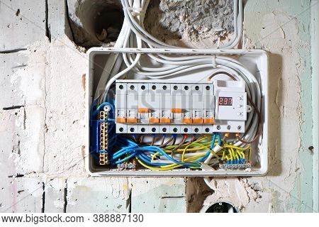 Installing The Circuit Breakers In Voltage Switchboard During The House Renovation