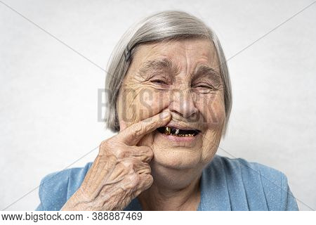 Toothless Elderly Woman. Happy Old Age Concept With A Cheerful Smiling Aged Woman Without Teeth.