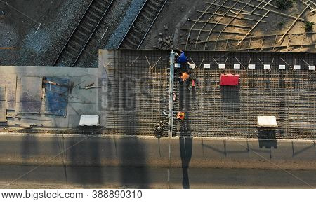 Aerial. High-altitude Works. Bridge Above The Railroad Restoration. Asphalt Pavement Renovations. To