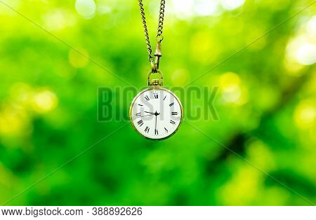 Old Pocket Watch On A Chain. Time Concept.