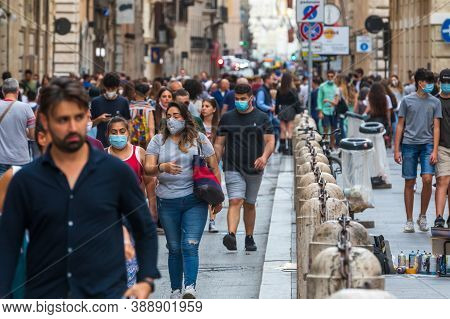 Rome, Italy. July 06, 2020: Crowd Of People During The Period Of The Covid Coronavirus Walking Throu
