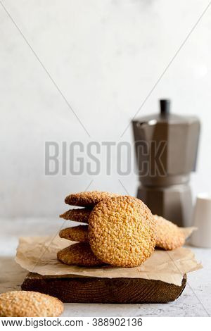 Cookies With Sesame Seeds On Gray Concrete Background. Healthy Snack With Sesame
