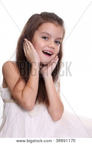 little amazing girl with blue eyes and opening mouth isolated on white