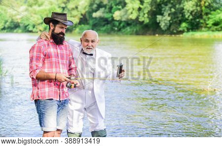 Where You Become Your Own Boss. Two Fishermen With Fishing Reel. Family, Granddad And Drandson Fishi