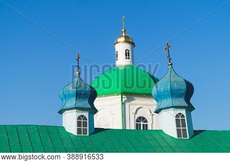 Colorful Domes Of Old Church With The Crosses. Clear Blue Sky