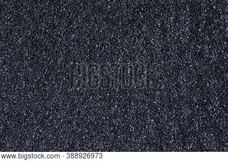 A Lot Of Healthy Black Sesame Seeds. Top View. Black Sesame Seeds On Background. Textured Background