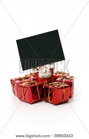 Santa Claus holding a sign isolated on white background.
