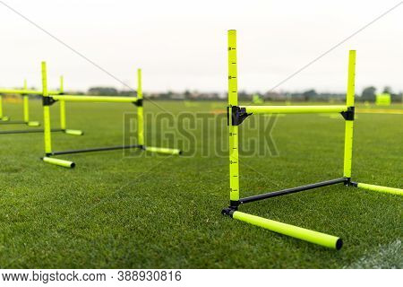Speed Training Hurdles. Yellow Durable Agility Hurdles. Sport Training Equipment On Grass Pitch