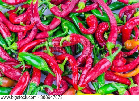 Background From Green And Red Chili Peppers. Chili Pepper Close Up.