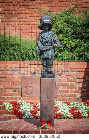Warsaw, Poland - 28 July 2020: Monument Of Little Boy Insurgent In Oversized German Helmet And Boots