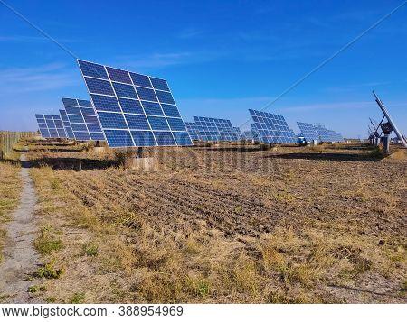 The Solar Panels Station At Ukraine. Use Solar Power, Solar Panels In Your Garden.