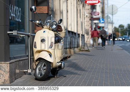 Riga, Latvia - October 8, 2020: A Classic, Elegant Vespa Scooter Parked On A Pedestrian Sidewalk In