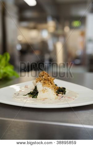 Plate of resteraunt food ready to go on the counter of kitchen