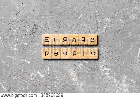 Engage People Word Written On Wood Block. Engage People Text On Cement Table For Your Desing, Concep