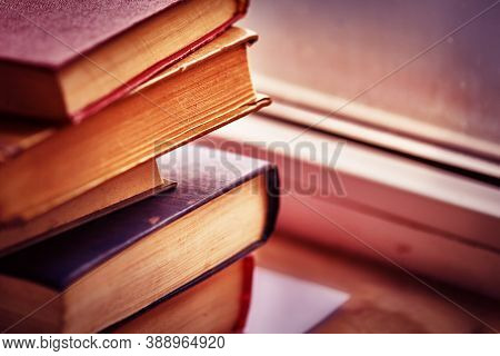 Old Books On The Windowsill. Old Books. Old Multi-colored Books.copy Space.background With Books In