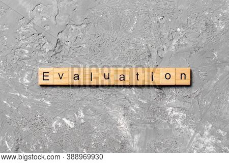 Evaluation Word Written On Wood Block. Evaluation Text On Table, Concept