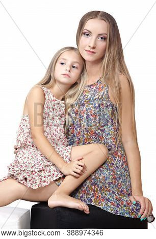 Two Adorable Little Sisters Hugging Each Other. Little Sister Put The Head On The Her Sister's Shoul