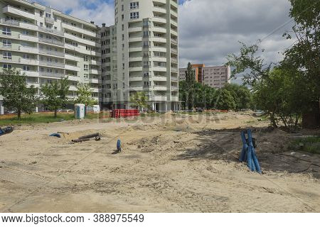 Warsaw, Poland - June 21, 2020: Landscape Construction Site, Laying Communication In The Ground. Lay