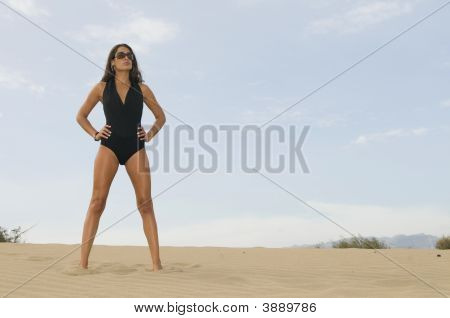 Woman In The Sand Dunes With Swimwear