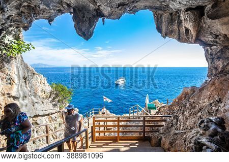 Sardinia, Italy. August 03, 2020: Entrance To A Sea Cave. The Grotta Del Fico Are Coastal Caves Loca