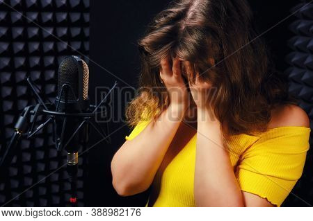 Woman In The Recording Studio Covered Her Face With Her Hands. Problems With Fatigue, Loss Of Voice