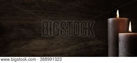 Burning Mourning Candles On Dark Wooden Background. Symbol For A Religious Mourning Ritual And Condo