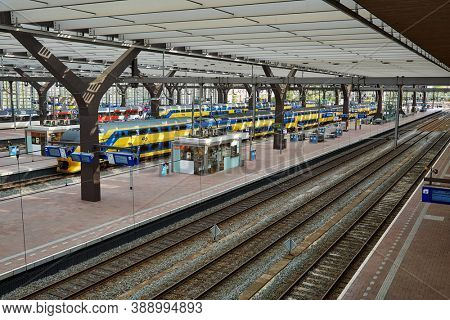 ROTTERDAM, THE NETHERLANDS - CIRCA 2017: Rotterdam Centraal, central station of Rotterdam with trains and platforms. The Netherlands has an efficient railway network