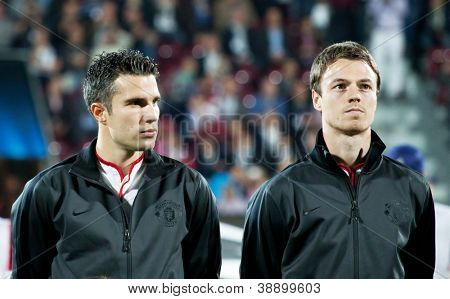 CLUJ-NAPOCA, ROMANIA - OCTOBER 2: van Persie and Evans in UEFA Champions League match between CFR 1907 Cluj and Manchester United, on 2 Oct., 2012 in Cluj-Napoca, Romania
