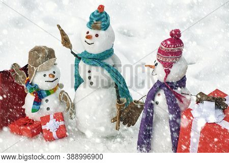 Handmade Snowman In The Snow Outdoor. Greeting Snowman. Winter Snowman Family. Mother Snow-woman, Fa