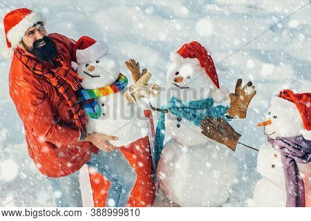 Enjoying Nature Wintertime. Winter Man. Christmas Man And Snowman On White Snow Background. Snowman