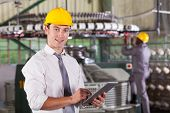 modern textile factory manager using tablet computer poster