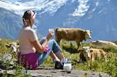 Girl with a jug of milk and cows. Jungfrau region, Switzerland poster