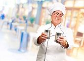 Portrait Of A Chef Holding Tin Cans, Indoor poster