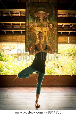 Woman doing vrksasana - tree pose