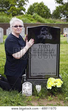 Sister Visits Grave Of Yomo Toro
