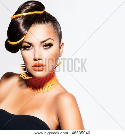Fashion Model Girl Portrait with Yellow and Orange Makeup. Creative Hairstyle. Hairdo. Make up. Beauty Woman isolated on a White Background