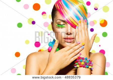 Beauty Girl Portrait with Colorful Makeup, Hair, Nail polish and Accessories. Colourful Studio Shot of Funny Woman. Vivid Colors. Manicure and Hairstyle. Rainbow Colors