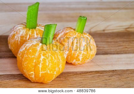 Halloween child friendly treats with clementines made to look like pumpkins