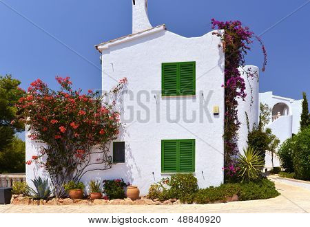 Typical House With Flower Pots In Mallorca, Spain