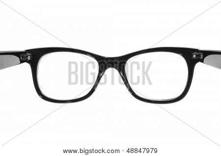 closeup of a black plastic rimmed eyeglasses on a white background, open as in the action to put them on
